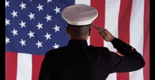 American Serviceman Salutes Flag