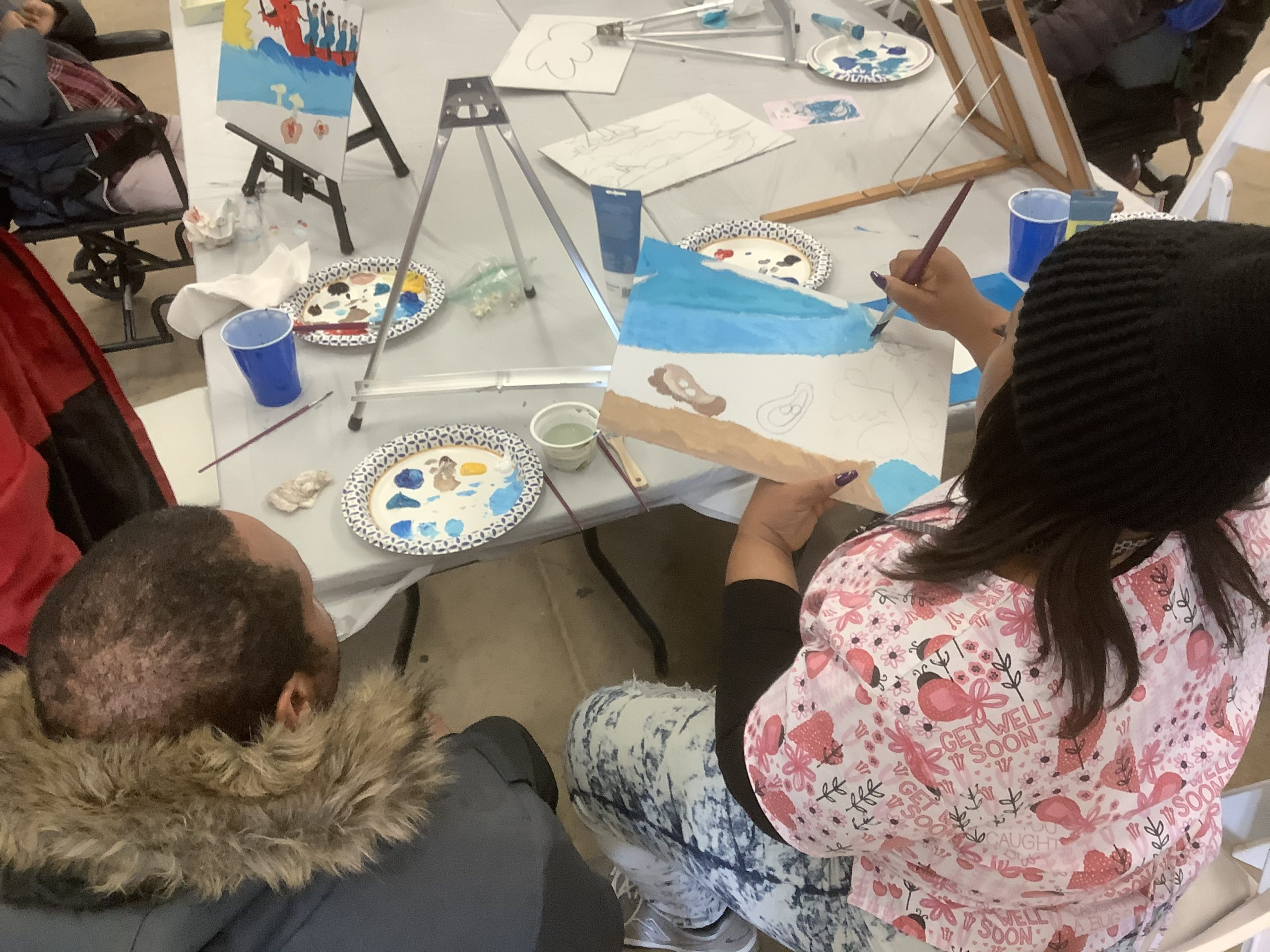 "painting portion of ""Bridge to the Community"" mosaic"